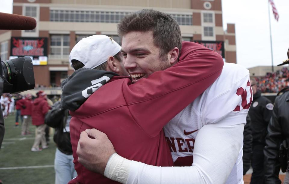 Oklahoma coach Bob Stoops hugged Blake Bell after the QB passed for 140 yards and a TD off the bench.